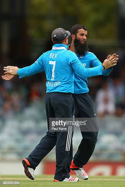 Ian Bell and Moeen Ali of England celebrate after the dismissal of Virat Kohli of India during the One Day International match between England and...