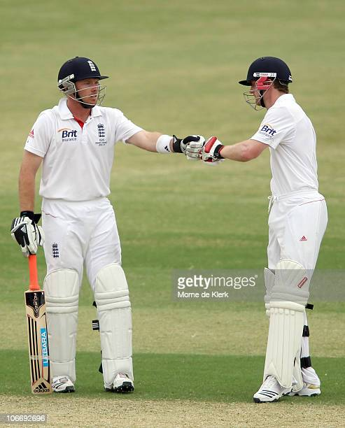 Ian Bell and Paul Collingwood of England encourage each other during day one of the Tour Match between the South Australian Redbacks and England at...