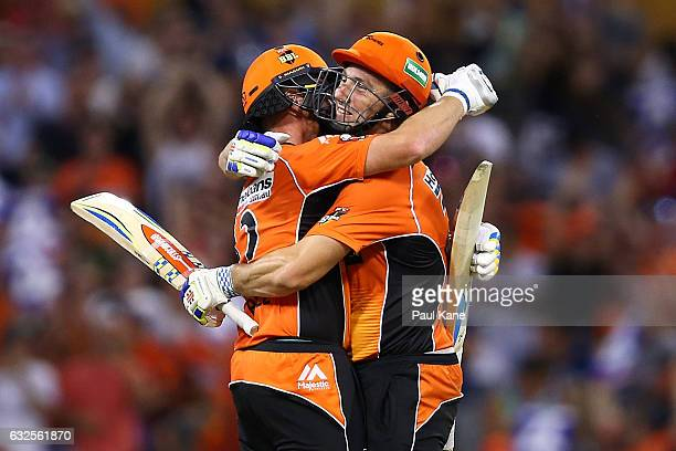 Ian Bell and Shaun Marsh of the Scorchers celebrate winning the Big Bash League match between the Perth Scorchers and the Melbourne Stars at the WACA...