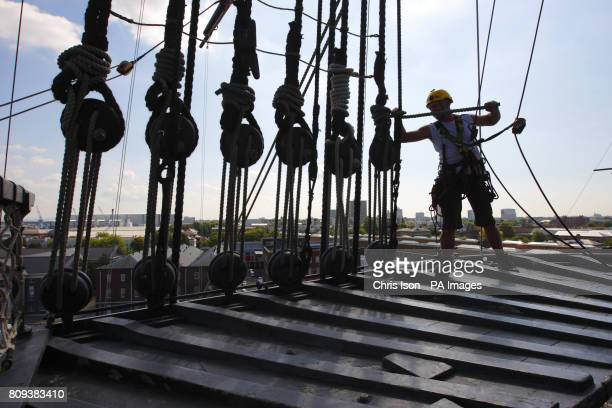 Ian Bell dismantles the rigging on the Fighting Top platform on the main mast 30 metres above the deck of Admiral Lord Nelson's flagship HMS Victory...