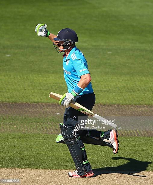 Ian Bell of England celebrates after reaching his century during the One Day International Tri Series match between Australia and England at...