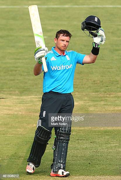Ian Bell of England celebrates his century during the tour match between the Prime Ministers XI and England at Manuka Oval on January 14 2015 in...