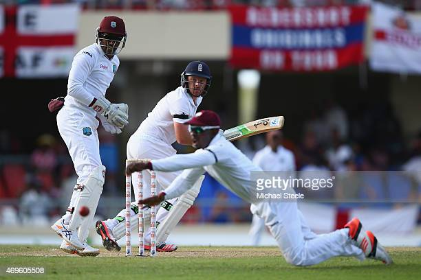 Ian Bell of England cuts a delivery past the reach of Devon Smith at first slip to reach his century during day one of the 1st Test match between...