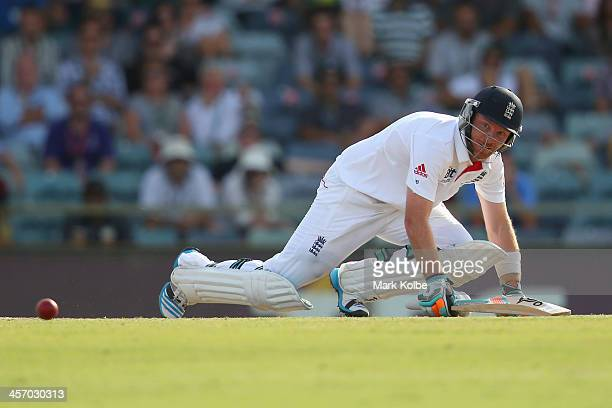 Ian Bell of England falls after playing a shot during day four of the Third Ashes Test Match between Australia and England at WACA on December 16...