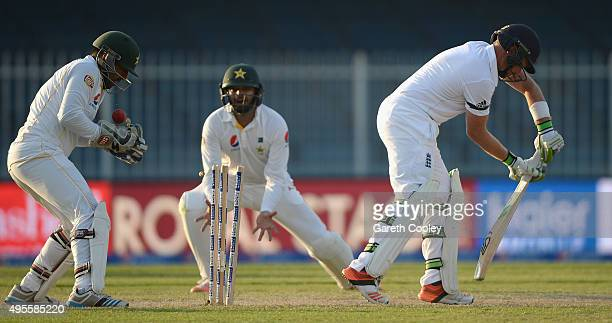 Ian Bell of England is bowled by Shoaib Malik of Pakistan during day four of the 3rd Test between Pakistan and England at Sharjah Cricket Stadium on...