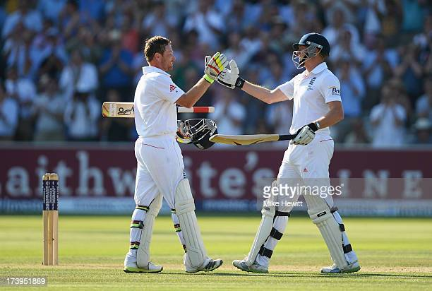 Ian Bell of England is congratulated by Jonny Bairstow after reaching his century during day one of the 2nd Investec Ashes Test match between England...