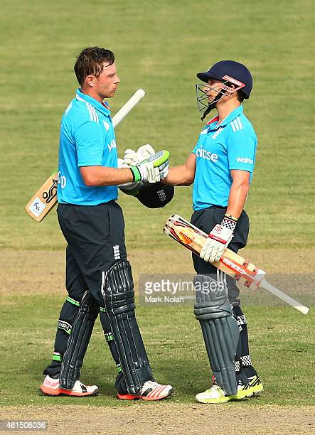 Ian Bell of England is congratulated by team mate James Taylor after scoring a century during the tour match between the Prime Ministers XI and...