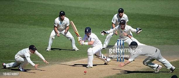 Ian Bell of England is surrounded by New Zealand fielders as he defends his wicket during day five of the Third Test match between New Zealand and...