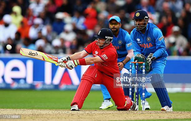 Ian Bell of England plays a reverse sweep as MS Dhoni of India looks on during the ICC Champions Trophy Final between England and India at Edgbaston...
