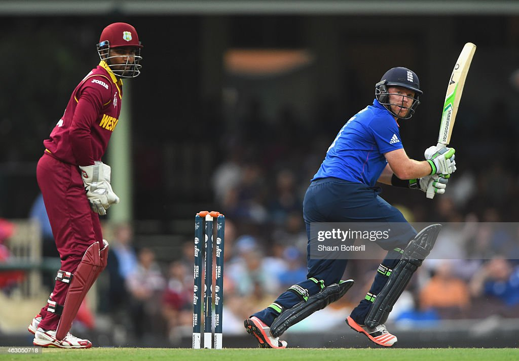 Ian Bell of England plays a shot as Denesh Ramdin of West Indies looks on during the ICC Cricket World Cup warm up match between England and the West Indies at Sydney Cricket Ground on February 9, 2015 in Sydney, Australia.