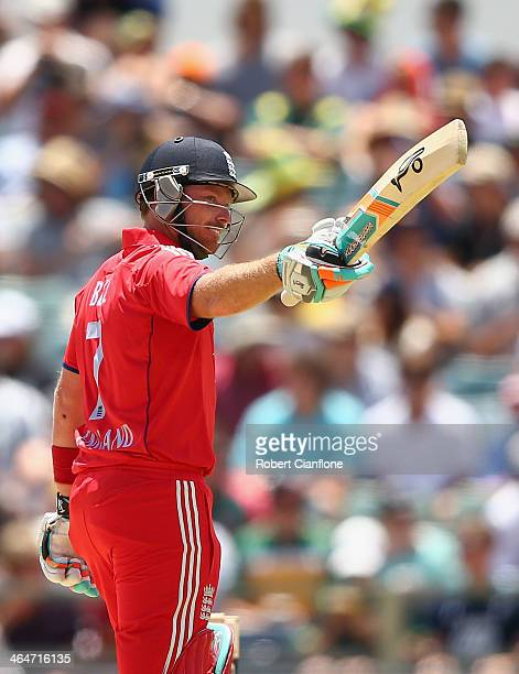 Ian Bell of England raises his bat after scoring his half century during game four of the One Day International series between Australia and England...