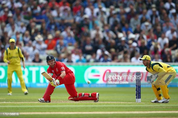 Ian Bell of England sweeps to the legside as wicketkeeper Matthew Wade of Australia looks on during the Group A ICC Champions Trophy match between...