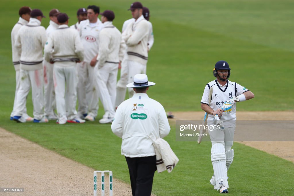 Ian Bell of Warwickshire heads back to the pavillion after being caught by Scott Borthwick off the bowling of Mark Footitt for 33 runs during day one of the Specsavers County Championship Division One match between Warwickshire and Surrey at Edgbaston on April 21, 2017 in Birmingham, England.