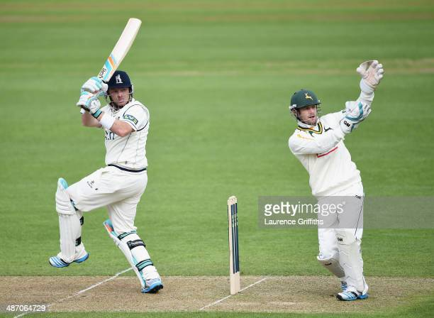 Ian Bell of Warwickshire hits out past Chris Read of Nottinghamshire during day one of the LV County Championship division one match between...