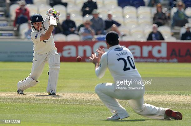 Ian Bell of Warwickshire plays a drive during day one of the LV County Championship match between Sussex and Warwickshire at The Brighton and Hove...