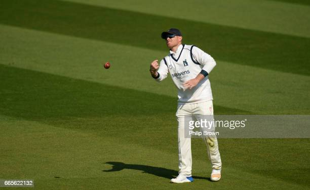 Ian Bell of Warwickshire throws the ball during day one of the Specsavers County Championship Division One cricket match between Surrey and...
