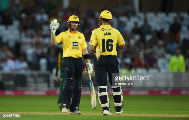 Ian Bell shakes Sam Hain's hand after they beat Nottingham during the Vitality Blast match between Nottingham Outlaws and Birmingham Bears at Trent...