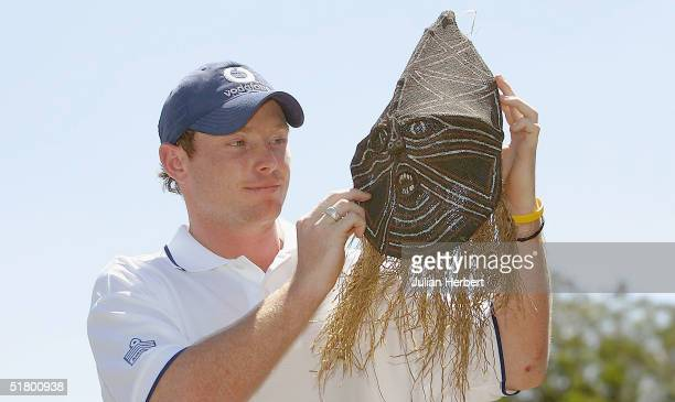 Ian Bell who was the top scorer in yesterdays 1st One Day International looks at a tribal mask as he walks round a craft market on November 29 2004...