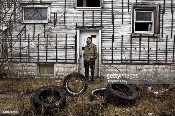 Ian Benniston a leader in the Youngstown Neighborhood Association walks through a vacant home on February 7 2012 in Youngstown Ohio High crime and...