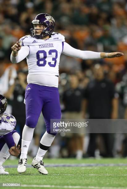 Ian Berryman of the Western Carolina Catamounts follows his extra point attempt in the second quarter of the game against the Hawaii Rainbow Warriors...