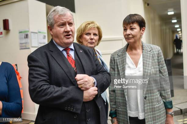 SNP MP Ian Blackford MP Independent Group for Change Anna Soubry and Green Party MP Caroline Lucas speak to media crews as they arrive for cross...