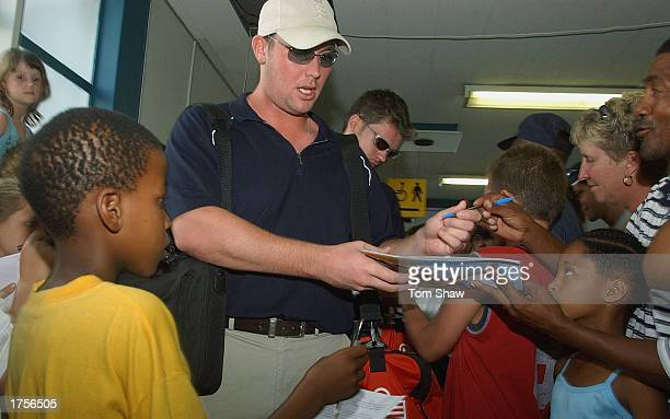 Ian Blackwell of England signs an autograph as the England team arrive at the Airport at the start of England's World Cup campaign at Port Elizabeth...