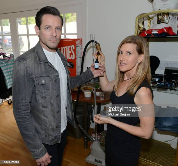 Ian Bohen and Denise Young trying CBD oil at The Artists Project Giveback Day with Ojai Energetics CBD Oil at the Artists Project on May 24 2017 in...