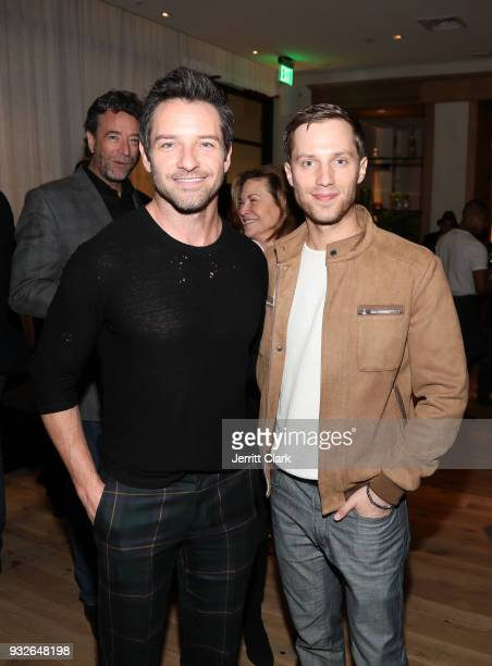 Ian Bohen and Jonathan Keltz attends the grand opening of FARMHOUSE Los Angeles on March 15 2018 in Los Angeles California