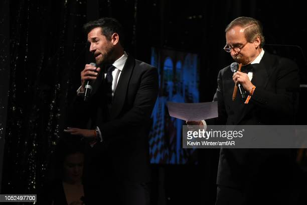 Ian Bohen and Simon de Pury speak onstage at the amfAR Gala Los Angeles 2018 at Wallis Annenberg Center for the Performing Arts on October 18, 2018...