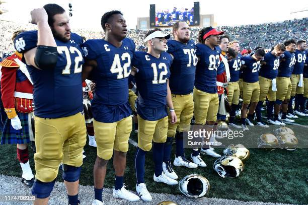 Ian Book Julian Okwara and teammates sing the alma mater after defeating the New Mexico Lobos at Notre Dame Stadium on September 14 2019 in South...