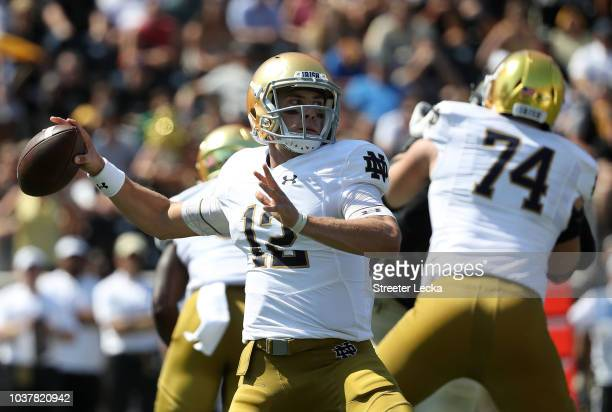 Ian Book of the Notre Dame Fighting Irish drops back to pass against the Wake Forest Demon Deacons during their game at BBT Field on September 22...