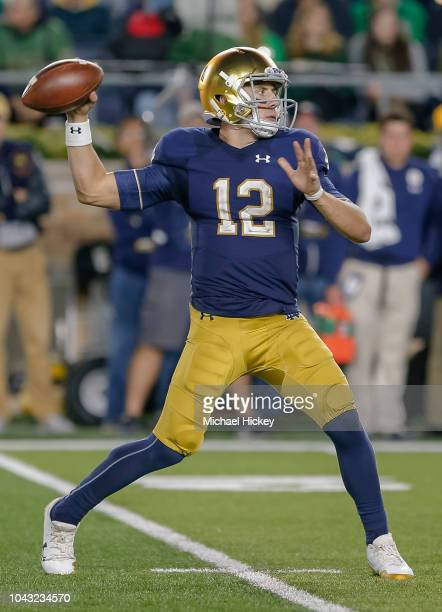 Ian Book of the Notre Dame Fighting Irish drops back to pass during the game against the Stanford Cardinal at Notre Dame Stadium on September 29 2018...