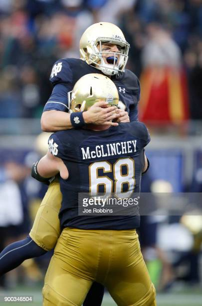 Ian Book of the Notre Dame Fighting Irish is lifted up by Mike McGlinchey after throwing the gamewinning 55yard touchdown to Miles Boykin in the...
