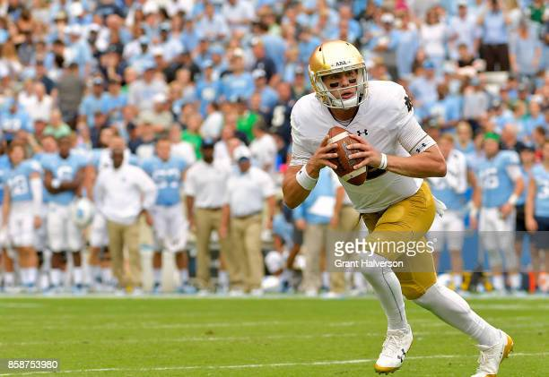 Ian Book of the Notre Dame Fighting Irish rolls out against the North Carolina Tar Heels during the game at Kenan Stadium on October 7 2017 in Chapel...