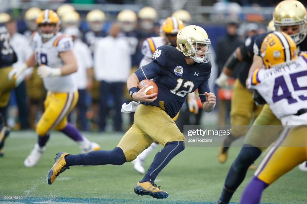 Ian Book #12 of the Notre Dame Fighting Irish runs for a first down in the fourth quarter of the Citrus Bowl against the LSU Tigers on January 1, 2018 in Orlando, Florida. Notre Dame won 21-17.