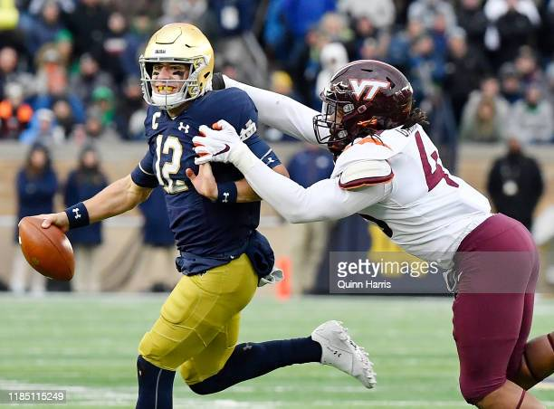 Ian Book of the Notre Dame Fighting Irish runs with the football in the second half against the Virginia Tech Hokies at Notre Dame Stadium on...