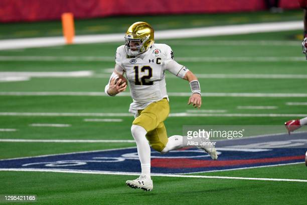 Ian Book of the Notre Dame Fighting Irish scrambles for yards during the College Football Playoff Semifinal at the Rose Bowl football game against...