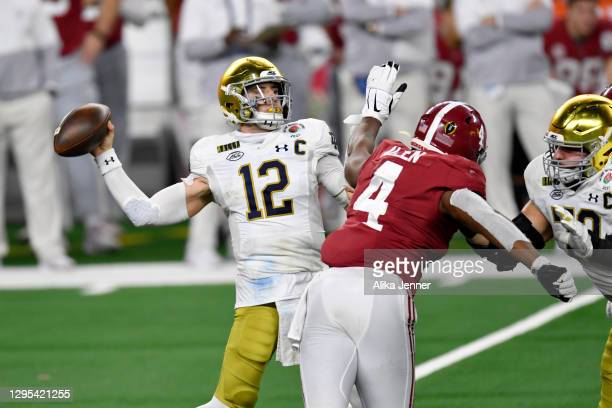 Ian Book of the Notre Dame Fighting Irish throws the ball with pressure from Christopher Allen of the Alabama Crimson Tide during the College...