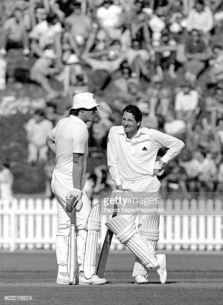 Ian Botham and Derek Randall of England talk midpitch during their partnership of 232 runs in the 1st Test match between New Zealand and England at...