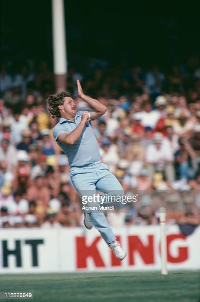 Ian Botham bowls during a match being played in Melbourne January 1983