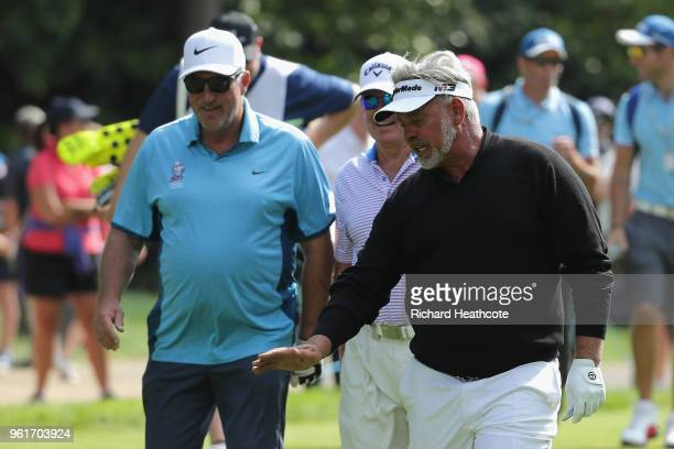 Ian Botham chats to Darren Clarke during the Pro Am for the BMW PGA Championship at Wentworth on May 23, 2018 in Virginia Water, England.