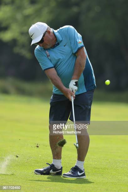 Ian Botham hits an approach during the Pro Am for the BMW PGA Championship at Wentworth on May 23, 2018 in Virginia Water, England.