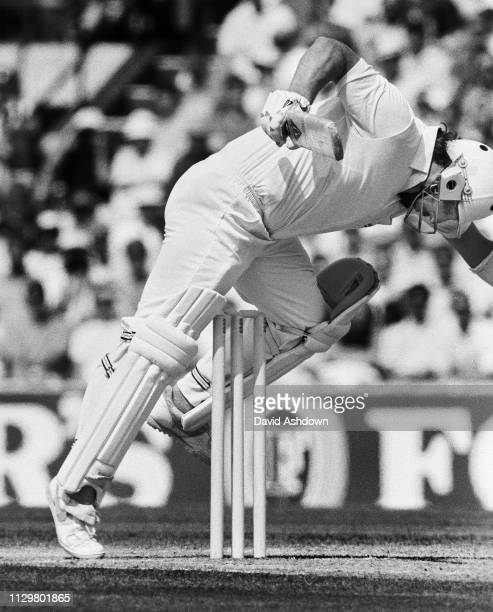 Ian Botham knocks the bail off in the 1st Innings after a ball by Curtley Ambrose at the 5th test between England and West Indies at the Oval in...