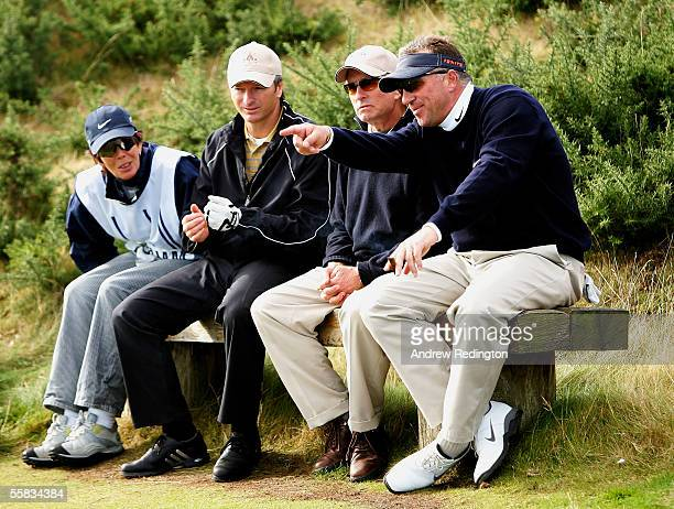 Ian Botham, Michael Douglas, Steve Waugh and caddie wait to play the 12th hole during the third round of the Dunhill Links Championships at...