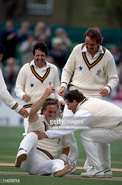 Ian Botham of Durham is congratulated by teammates Dean Jones Paul Parker and David Graveney after taking a catch to dismiss Viv Richards of...