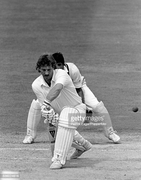 Ian Botham of England batting during the 5th Test match between England and Pakistan at The Oval London August 1987 The wicketkeeper for Pakistan is...