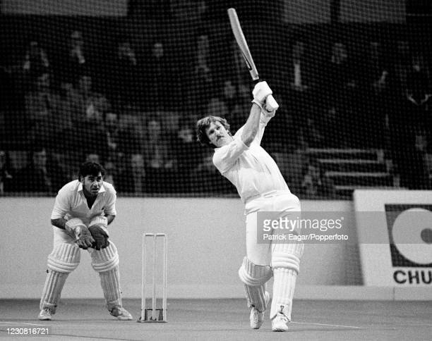 Ian Botham of England batting during the Chubb World Double Wicket Championship at Wembley Arena, London, 19th April 1979. The wicketkeeper is Farokh...