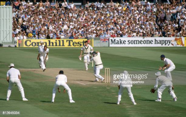 Ian Botham of England bowling to Graham Yallop of Australia batting during his 2nd innings score of 116 in the 5th Test match between England and...