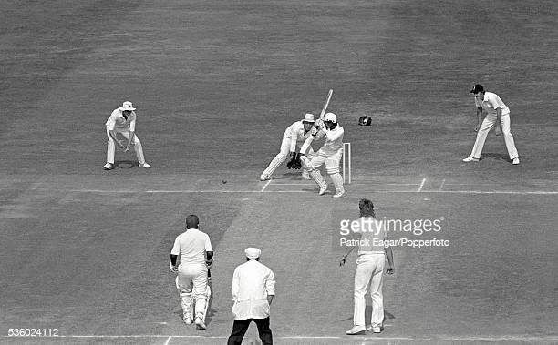 Ian Botham of England bowls spin to SAR Silva of Sri Lanka during his innings of 102 not out in the only Test match between England and Sri Lanka at...