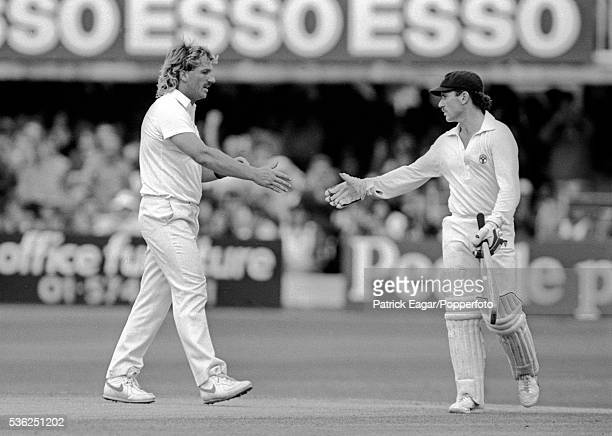Ian Botham of England congratulates Allan Border of Australia on reaching 150 runs during his innings of 196 in the 2nd Ashes Test Match between...